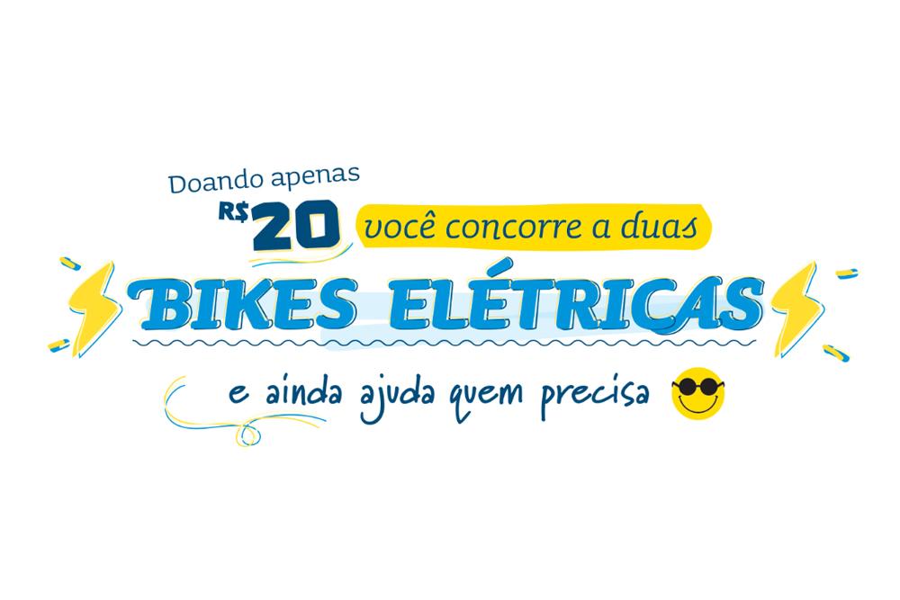 """Descrição da imagem: banner virtual com o texto """"Doando apenas R$ 20 você concorre a duas bikes elétricas e ainda ajuda quem precisa"""""""